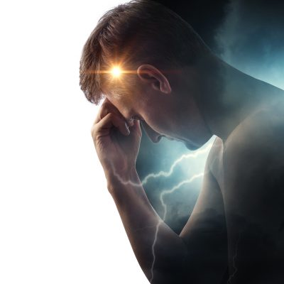Storm sky with lightning and sun on the background of the silhouette of a man. Concept on the theme of the struggle between good and evil or the theme of medicine (migraine and headache pain )